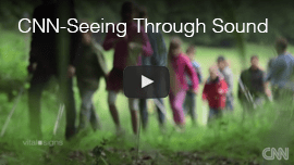 CNN: Seeing Through Sound. Video image: Daniel Kish walking with a group of blind children near a forest in Germany.