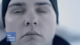Video thumbnail screengrab shows the Weather Channel logo in the foreground of a frontal close-up J Steele-Louchart as he closes his eyes and concentrates.