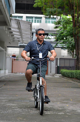 Photo: Juan Ruiz rides a bicycle in Bangkok, Thailand.