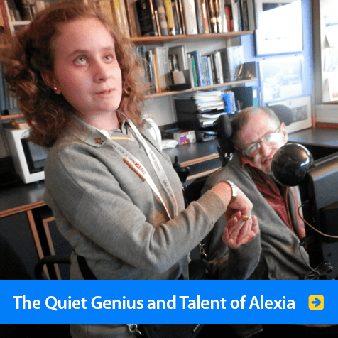 The quiet genius and talent of Alexia. Image shows Alexia standing beside, and holding the hand of professor Stephen Hawking at Cambridge University.