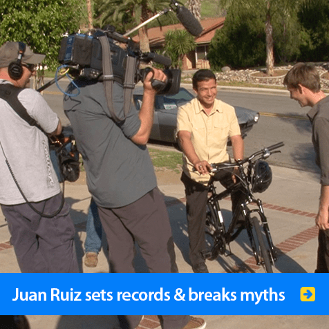 Juan Ruiz sets records and breaks myths. Photo shows a video crew interviewing Juan on his bicycle on a tree-lined street. Click to go to his page.