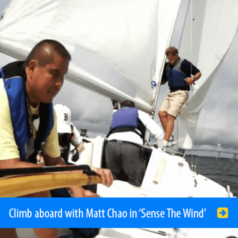 Climb aboard with Matt Chao in 'Sense The Wind'. Still from the film shows Matt at the helm in a sailing race.