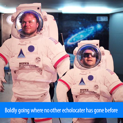 Boldly going where no echolocaters have gone before. Image: Brian and Juan pose with their heads inside cutouts of space suits.