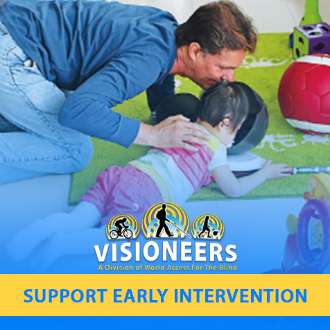 Visioneers. Support Early Intervention. Image: Lead Visioneer Daniel Kish makes FlashSonar clicks into a bowl as he instructs Little Ran at her level on a carpet.