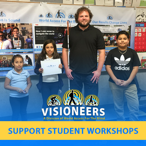 Visioneers. Support Student Workshops. Image: Photo shows Senior Visioneer Brian Bushway with students at a FlashSonar workshop during a Science Fair at their school in Los Angeles.