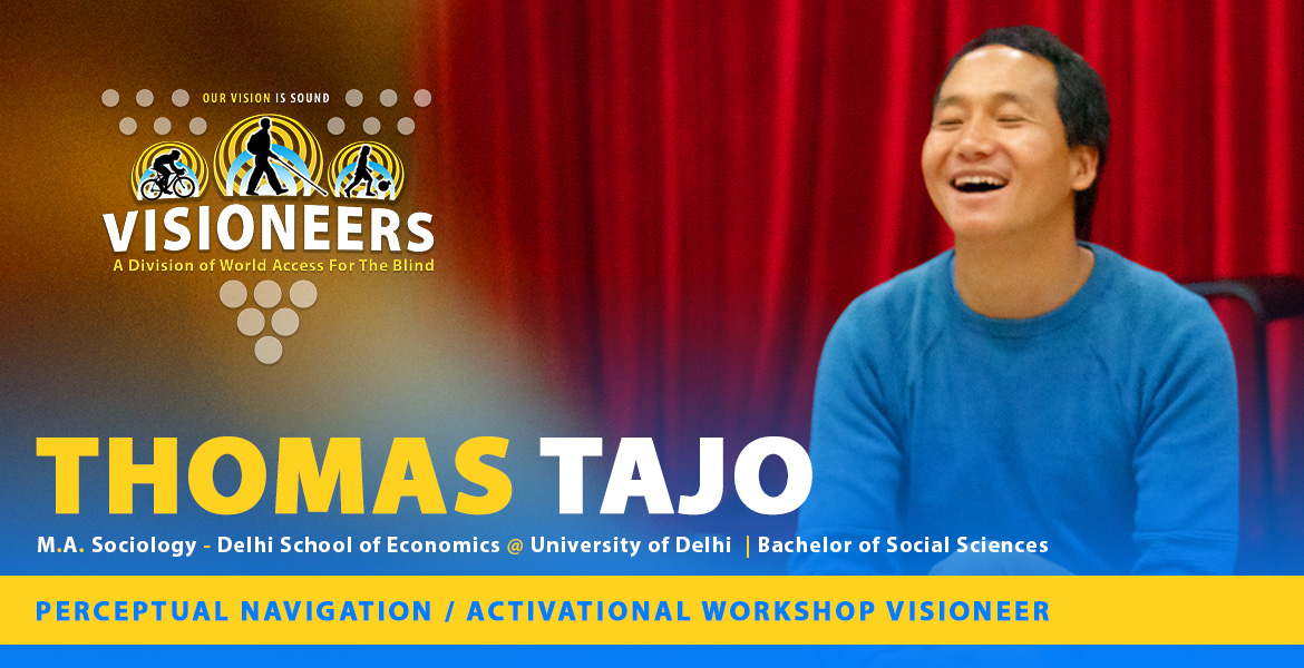 Thomas Tajo - Masters Degree in Sociology - Delhi School of Economics @ University of Delhi | Bachelor of Social Sciences. Perceptual Navigation / Activational Workshop Visioneer. Photo shows Thomas laughing onstage at a workshop in Moscow.