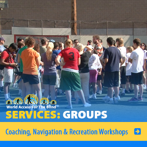 Services: Groups: Coaching, Navigation and Recreation workshops. Image: Photo shows WAFTB Perceptual Navigation Instructor Brian Bushway at the center of a large group at a recreation workshop.