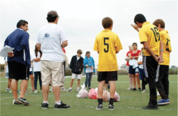 USA: Recreational Clinics. Photo of soccer clinic shows balls in plastic bags.
