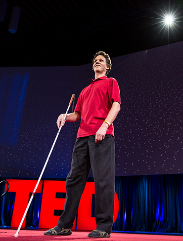 Photo of Daniel Kish on stage at the global TED Conference in Vancouver.