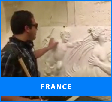 France. Image: Senior Multicultural Visioneer Juan Ruiz scouts sculpted entablature for tactile interest at the Louvre in Paris, ahead of a training session.