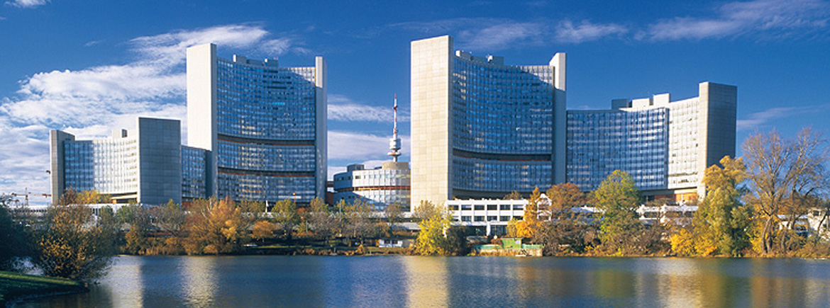 Photograph of the Vienna International Centre on the left bank of the Danube River which houses departments of the United Nations and the International Atomic Energy Agency.