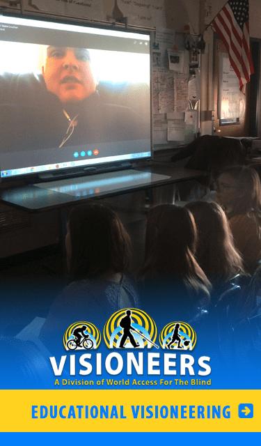 Educational Visioneering : Image: Workshop Visioneer J. Steele-Louchart speaks to a classroom of Science students via Skype on a large smart screen.