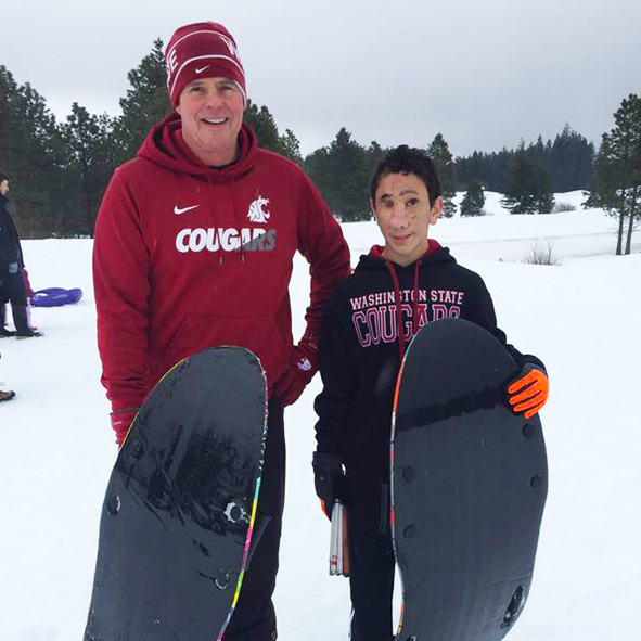 Photo of Humoody and his Dad Randy Smith out on the slopes with their snow boards.