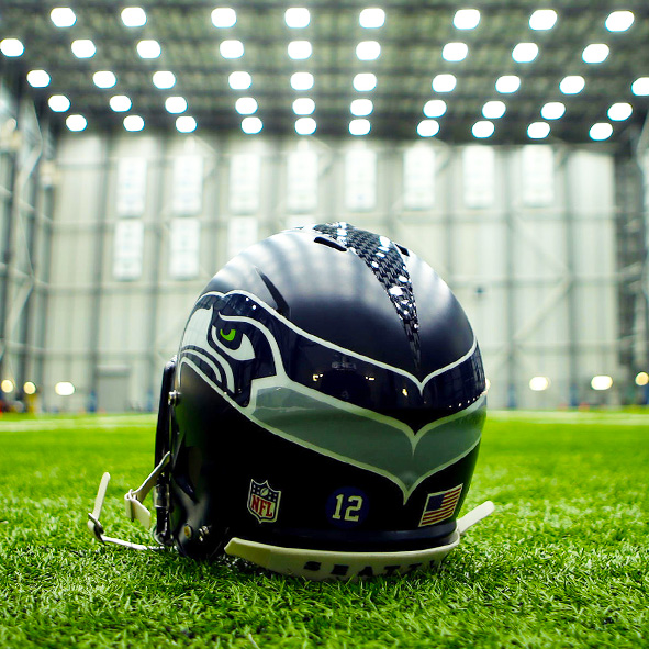 Photo: A Seattle Seahawks helmet sits on the astroturf inside the NFL team's Virginia Mason Athletic Center indoor practice facility.
