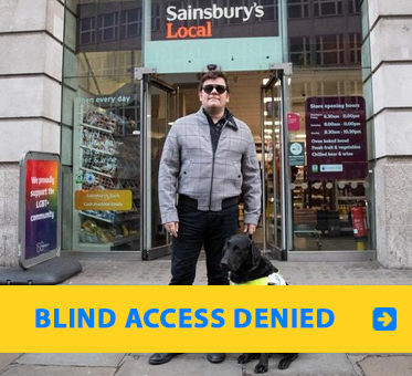 Blind Access Denied. Photo shows blind UK Paralympic skiing champion John Dickinson-Lilley standing with his guide dog outside a Sainsbury's Local market in London where he was denied access.