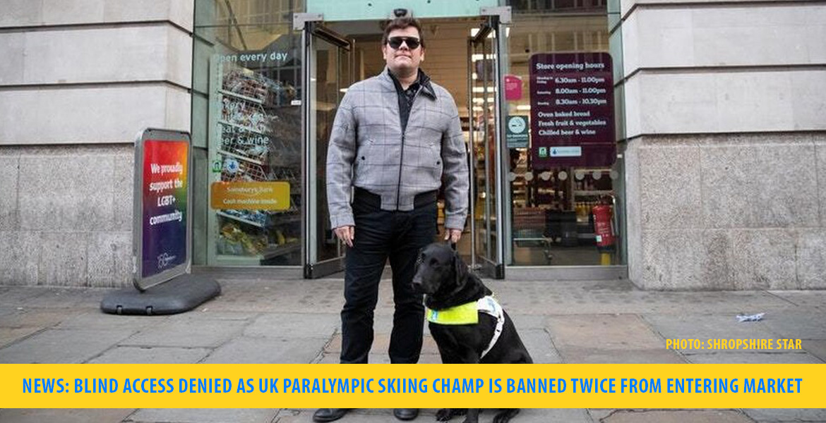 News: Blind access denied as UK Paralympic Skiing Champ is banned twice from entering market. Image: John Dickinson Lilley stands with his guide dog Brett in front of the Sainsbury's Local market in London, England where he has twice been denied access.