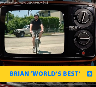 "Brian ""World's Best"": Video frame of an old RCA tv with an image of Brian Bushway riding his bicycle towards the camera."