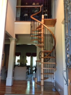 Spiral stair with White Oak treads and metal balusters