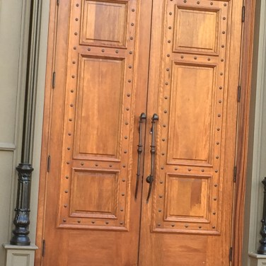 27 - Custom Double Mahogany solid panel doors with clavos nail heads