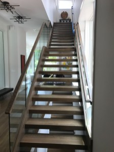 29 - Modern Freestanding open rise stair with glass