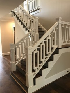 Farmhouse Straight stair with Custom cut-out wood balusters