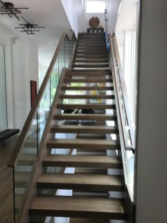 Modern Freestanding open rise stair with glass
