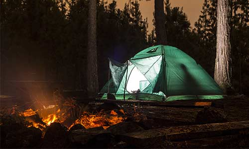 green tent outdoors camping