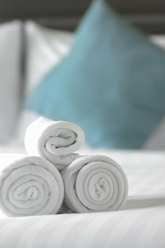 towels on hotel bed