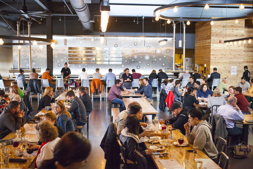 Interior shot of Surly Brewing with a full crowd of people