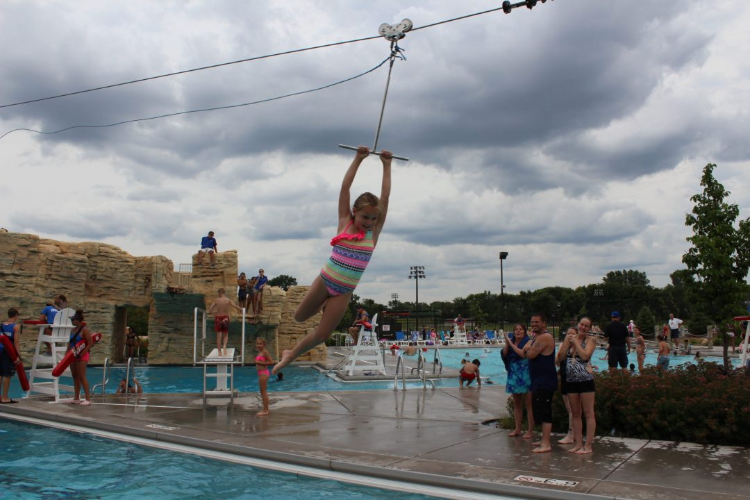 "Zip Line. Image by <a href=""https://www.stpaul.gov/departments/parks-recreation/aquatics/como-regional-park-pool"" target=""_blank"">St. Paul Parks & Recreation</a>"