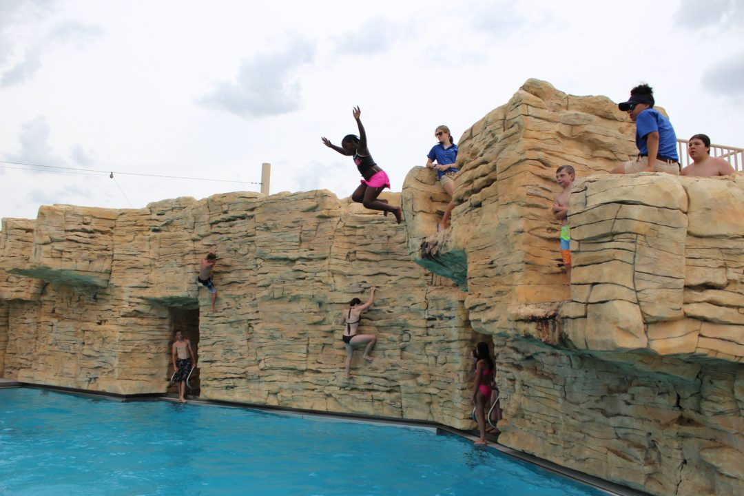 "Cliff Jumping. Image by  <a href=""https://www.stpaul.gov/departments/parks-recreation/aquatics/como-regional-park-pool"" target=""_blank"">St. Paul Parks & Recreation</a>"