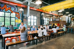 Bauhaus Brewery Interior with people hanging out and drinking beer