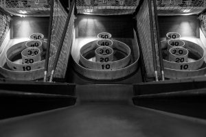 Skeeball lane in black and white