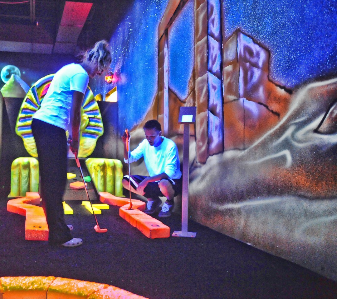 "Cosmic Mini Golf. Image by Airmaxx <a href=""http://www.airmaxxtrampolinepark.com/"" target=""_blank"">Airmaxx</a>"