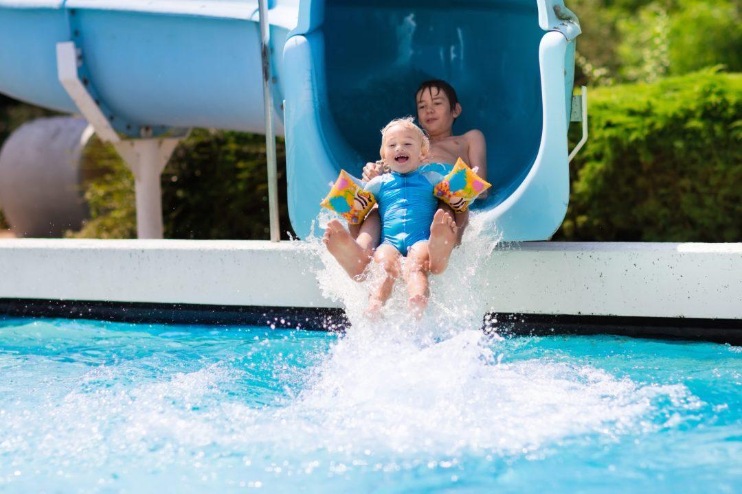 Kids on a Water Slide.