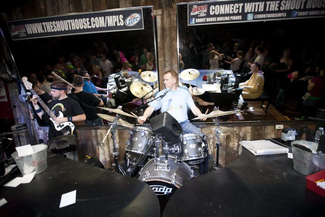 """Drums and Guitar Join the Party. Image by <a href=""""http://www.shouthousempls.com/mpls/default.asp"""" target=""""_blank"""">Shout House Dueling Pianos</a>"""