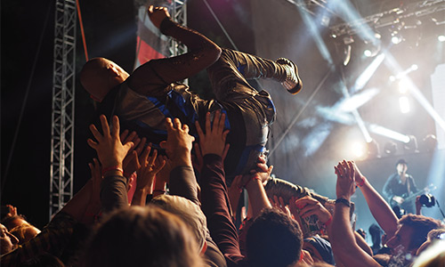 musician crowdsurfing at a show