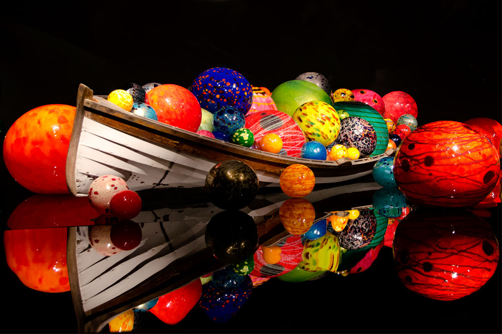 A boat full of colorful glass orbs.