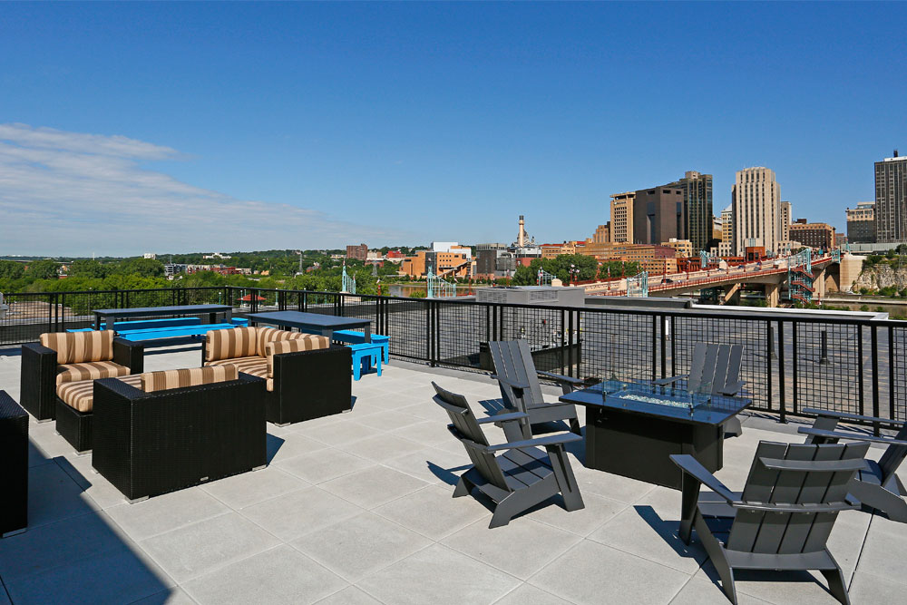 A view of the St. Paul skyline from the rooftop of a condo.