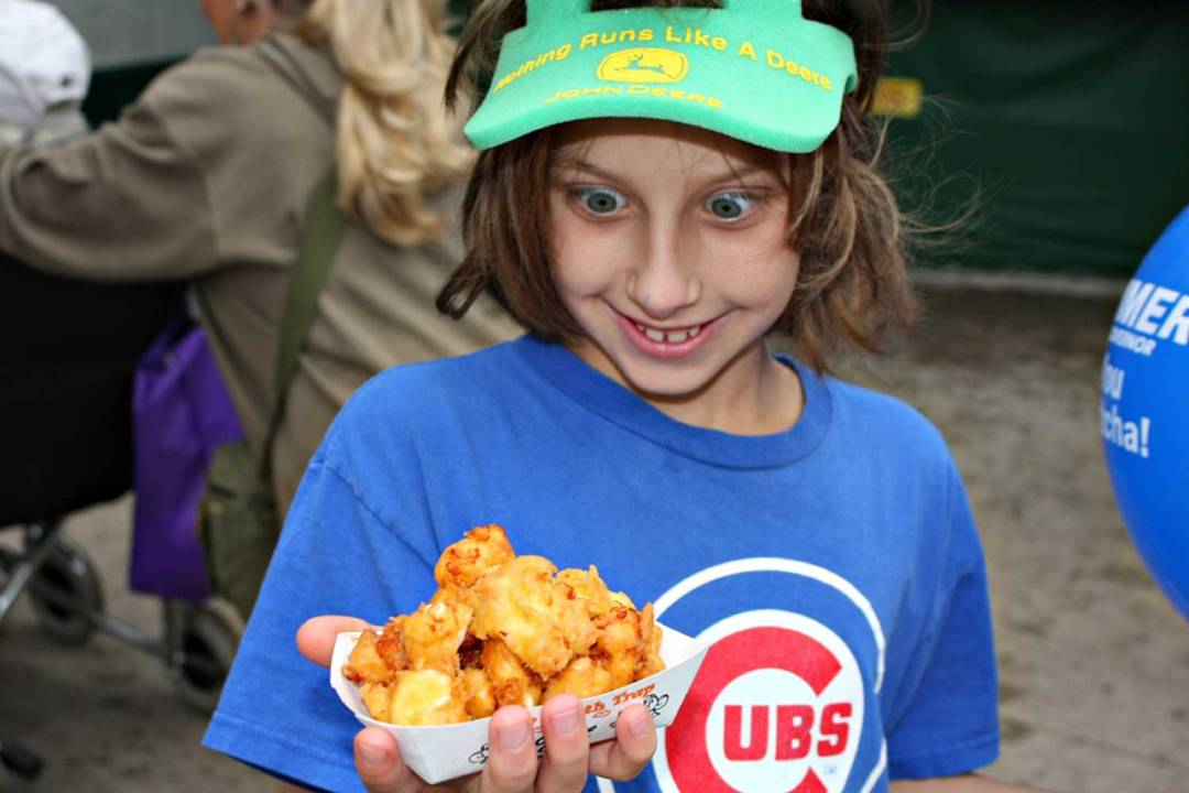 Kid eating cheese curds. Seven Wonders of the Twin Cities.