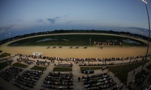 View of a twilight horse race from the stands at Running Aces Casino & Racetrack.