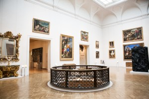 Inside the Minneapolis Institute of Art looking at hanging paintings on pristine white walls.