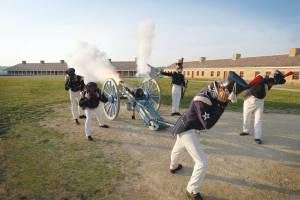 Soldiers firing a cannon at Fort Snelling, one of the many stops along the Metro Transit Blue Line.