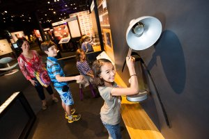 Young girl exploring the Science Behind Pixar exhibit at the Science Museum of Minnesota.