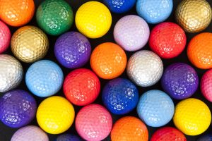 Photo of colorful mini golf balls.