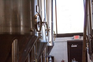 Large fermentation tanks at a brewery.