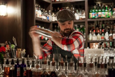 Jesse Held mixes a drink at Constantine.