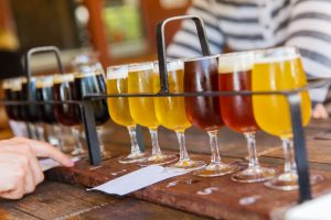 Flights of beer on a brewery table.   Breweries in the 'Burbs