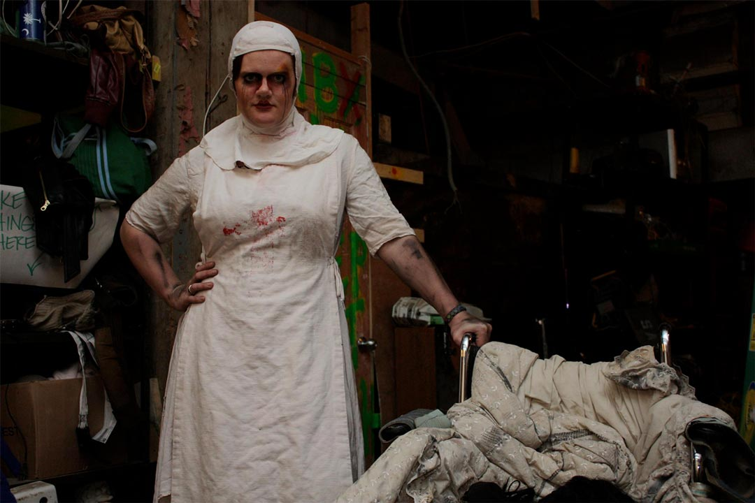 A nurse holding a wheelchair full of rags at the Haunted Basement, one of the many haunted houses in the Twin Cities.