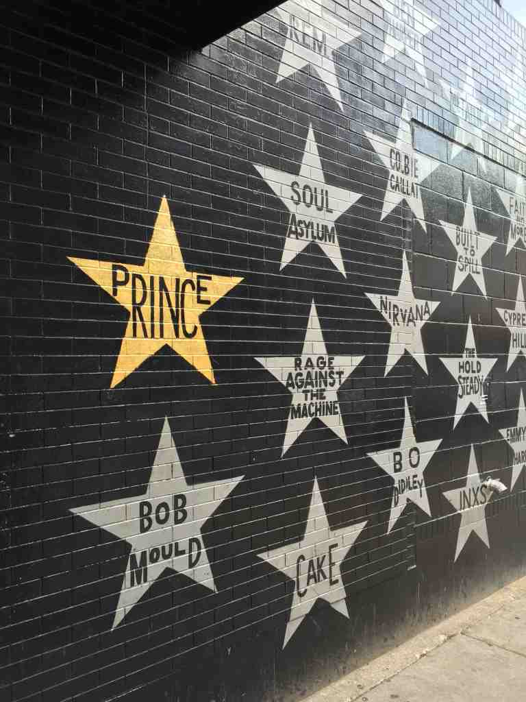 Photo by Kristen Montag, courtesy of Meet Minneapolis. Prince's golden-leafed star stands out on First Avenue's famous painted wall.